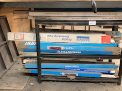 Three tier rack with large quantity of steel rules
