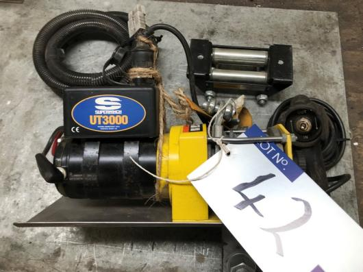 A Superwinch UT3000 Electric Winch with controller.…