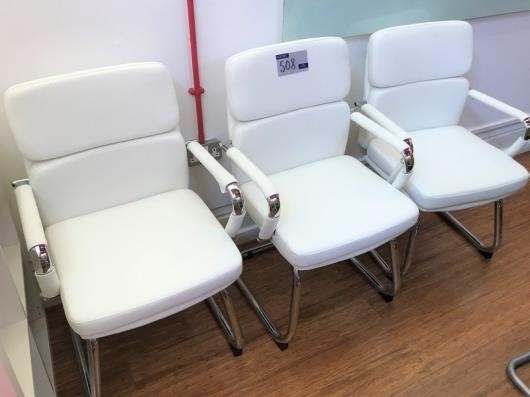 3 Chrome Framed White Faux Leather Upholstered Cantilever Armchairs