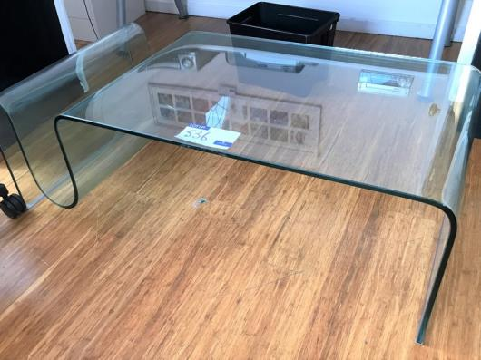 A Moulded Curved Glass Low Table, 1150mm x 600mm x 390mm (located at