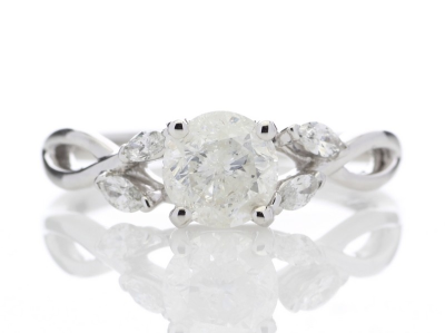 18ct White Gold Diamond Ring With Leaf Shoulders 1.07 CaratsA beautiful white D colour 0.91 carat diamond sits between …